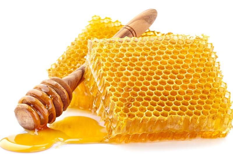 بيت شعر عن العسل والشمع